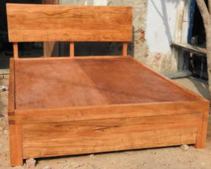 Wooden Bed with storage by The Beehive India